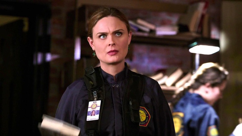 Brennan (Emily Deschanel) at a crime scene on Bones