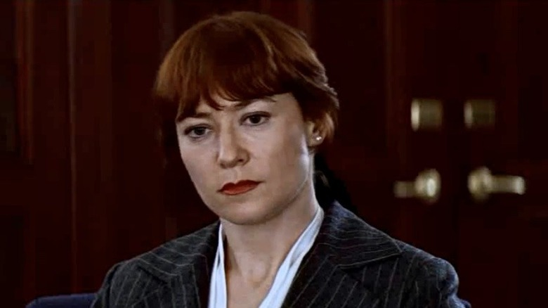 Ann Magnuson Moira Wolfson pensive pantsuit
