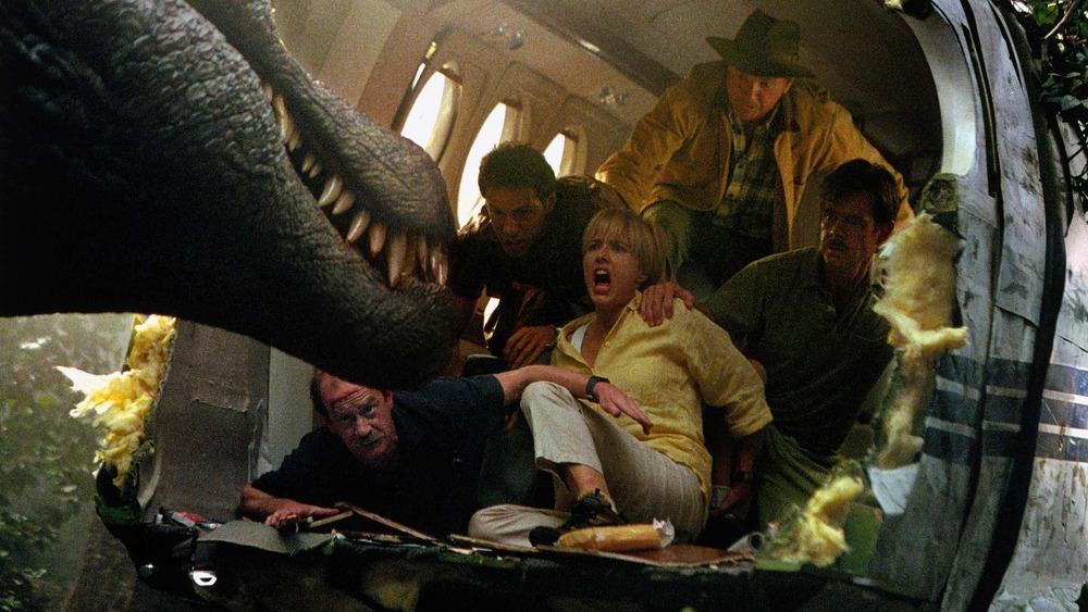 A spinosaurus, Micheal Jeter, Alessandro Nivola, Téa Leoni, Sam Neill, and William H. Macy in Jurassic Park III