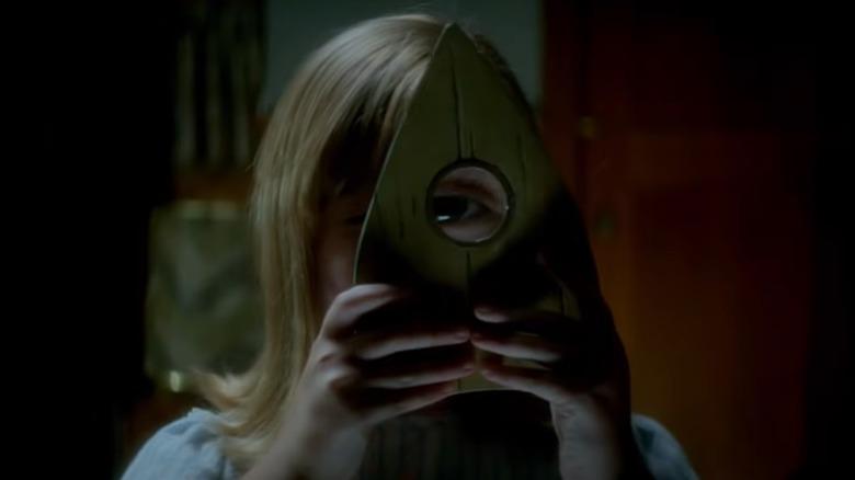 Ouija girl magnified eye