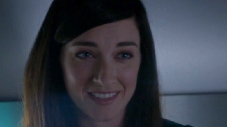 Delilah smiling after McGee proposes
