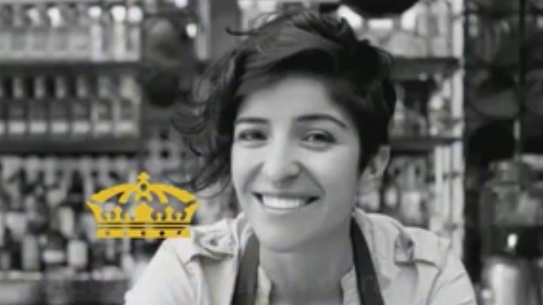 Female bartender smiling