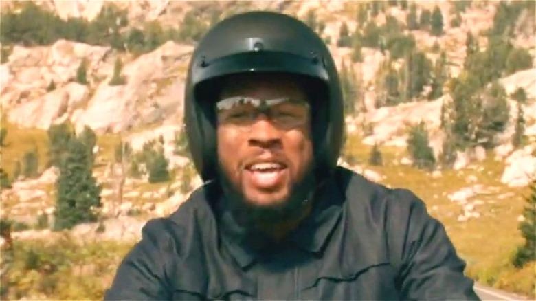 Man riding motorcycle sidebar groom