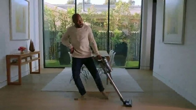 Man dancing while vacuuming