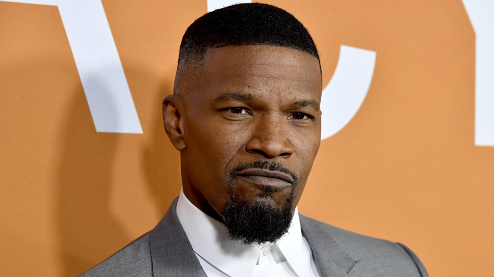 Jamie Foxx mugging for cameras at a premiere event
