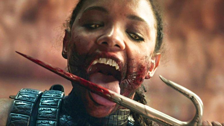 Mileena kicking bloody weapon