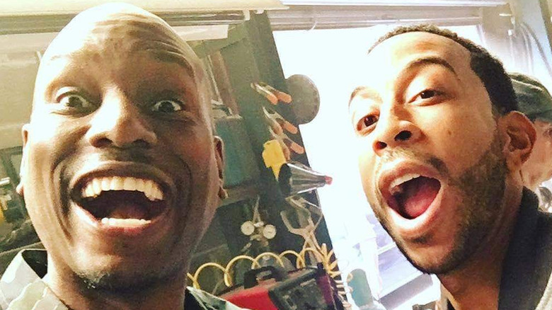 Tyrese Gibson and Ludacris mouths open grinning