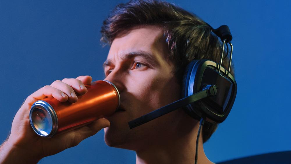 Gamer drinking energy drink.