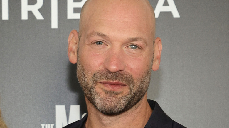 Corey Stoll smiling gray background