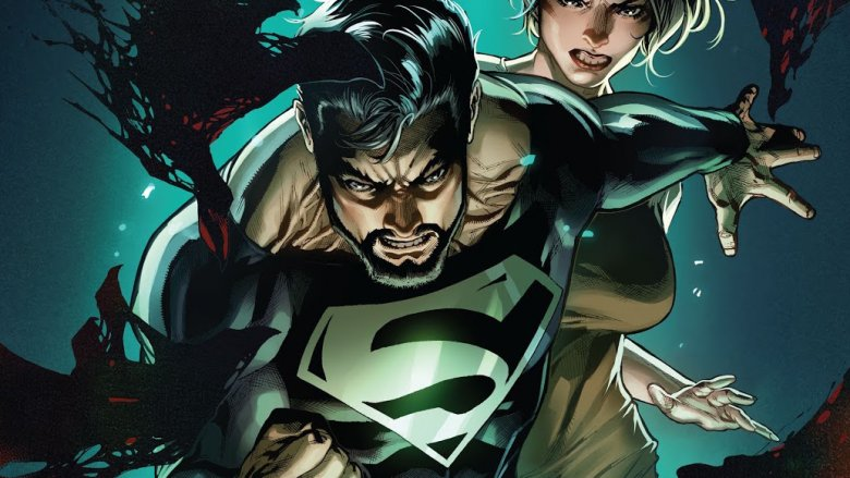 Superman in his black suit protecting Lois Lane from danger