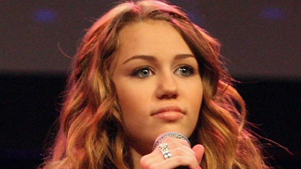Miley Cyrus holding microphone