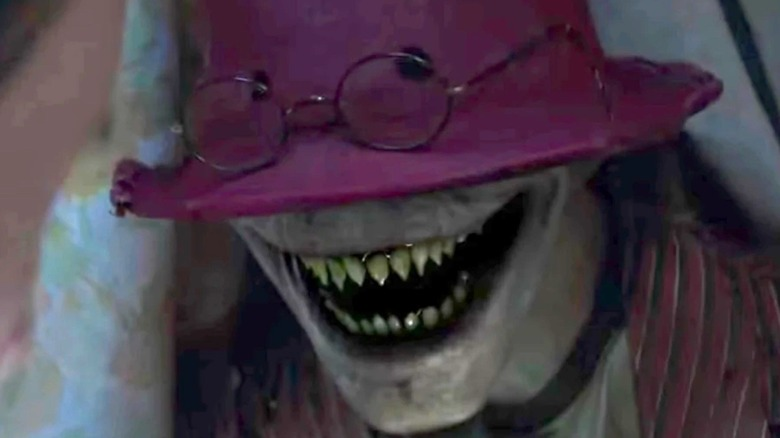 Crooked Man showing pointy teeth