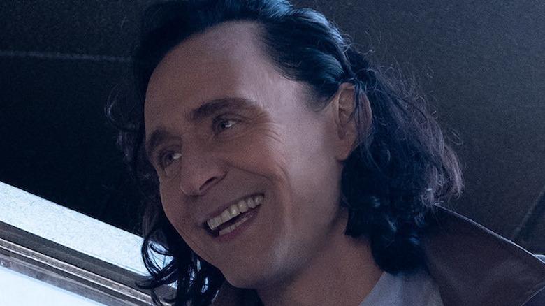 Tom Hiddleston as Loki smiling