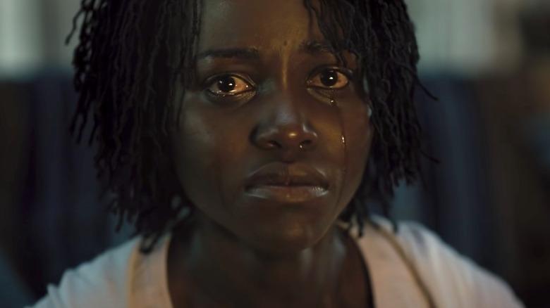 Lupita Nyong'o as Adelaide crying in Us