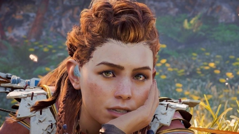 Aloy hand on face