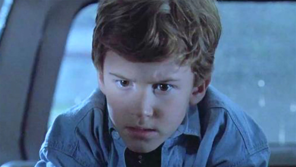 Young Tim from Jurassic Park concentrating on something off-camera