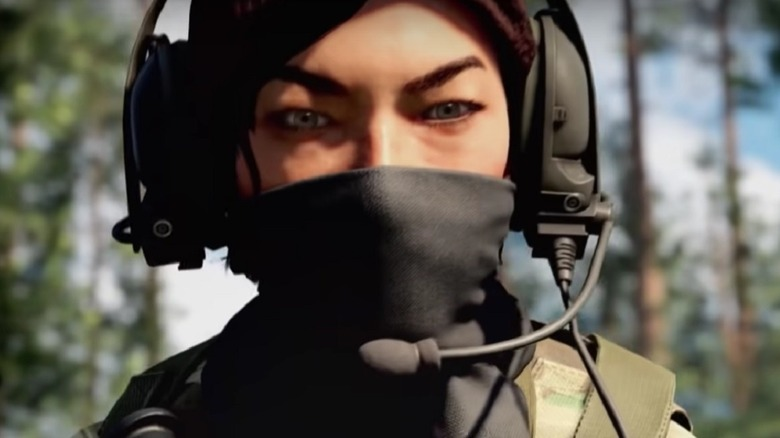 Woman wearing headset and mask