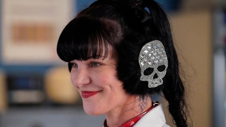 Pauley Perrette wears skull earmuffs on NCIS