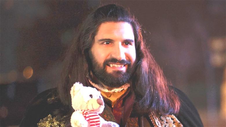 Nandor holding a teddy bear