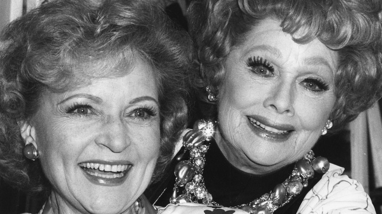 Betty White and Lucille Ball pose together