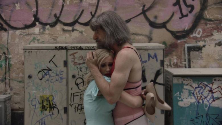 Borat and his daughter, Tutar, hug in Borat 2