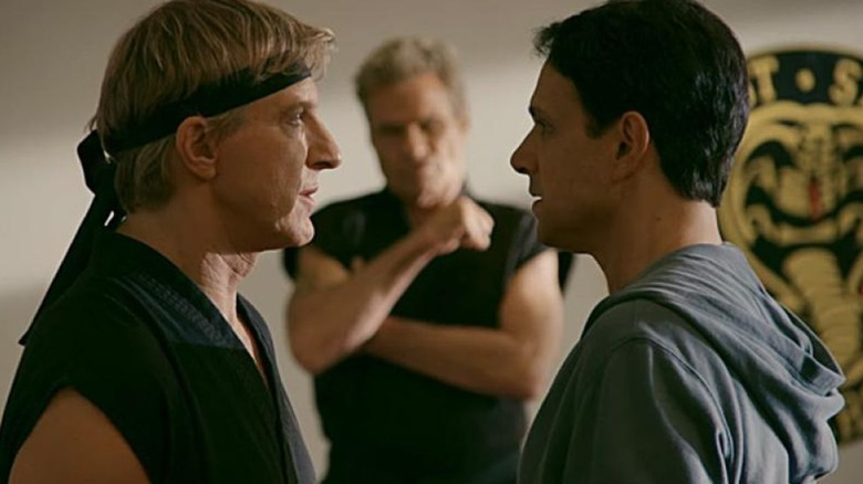 Ralph Macchio as Daniel LaRusso, Martin Kove as John Kreese, and William Zabka as Johnny Lawrence on Cobra Kai