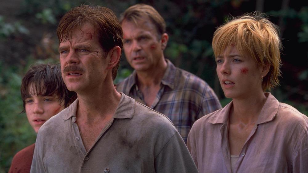 Trevor Morgan as Eric Kirby, William H. Macy as Paul Kirby, Sam Neill as Dr. Alan Grant, and Téa Leoni as Amanda Kirby in Jurassic Park III