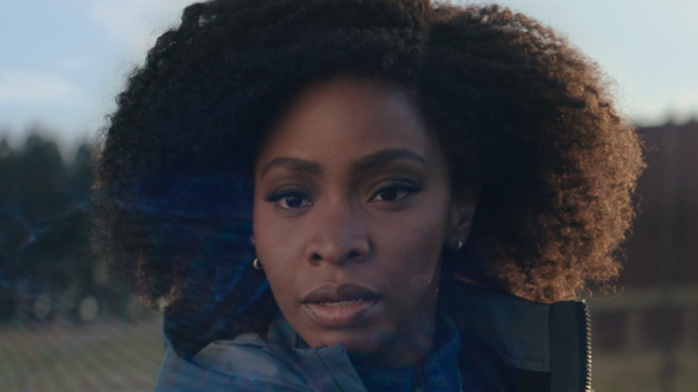 Monica Rambeau looking curiously at the Hex
