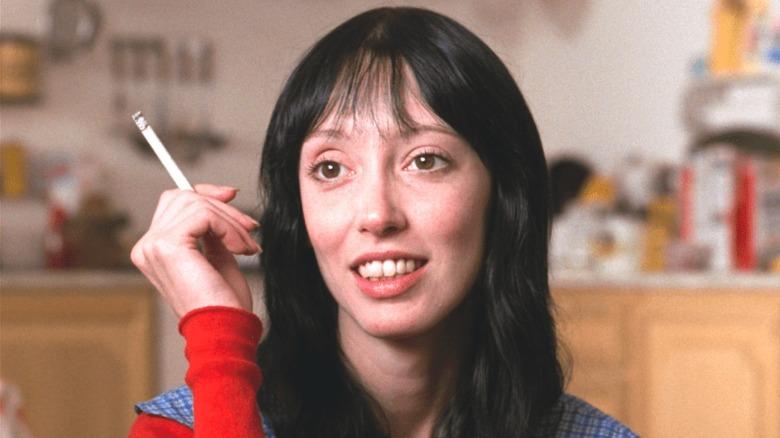 Wendy smoking in the kitchen