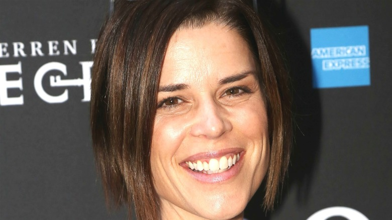 Neve Campbell smiling red carpet