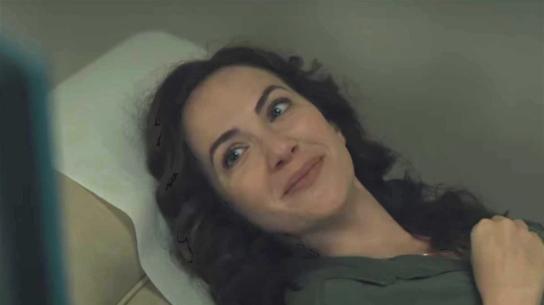 Kate Siegel laying down in Midnight Mass