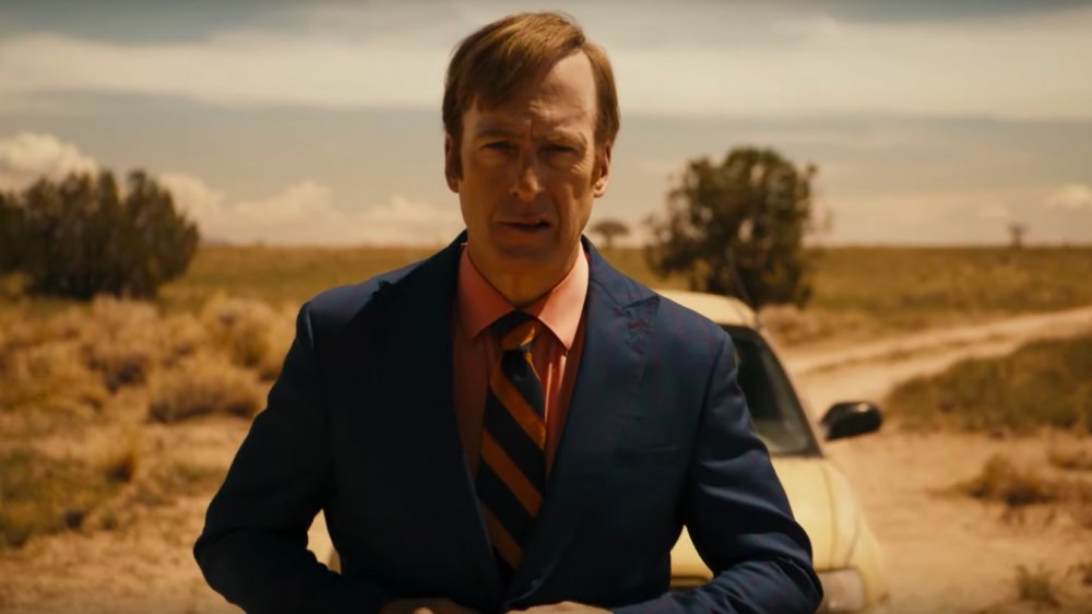 Bob Odenkirk as Jimmy McGill wears a suit in the desert and looks apprehensive in Better Call Saul