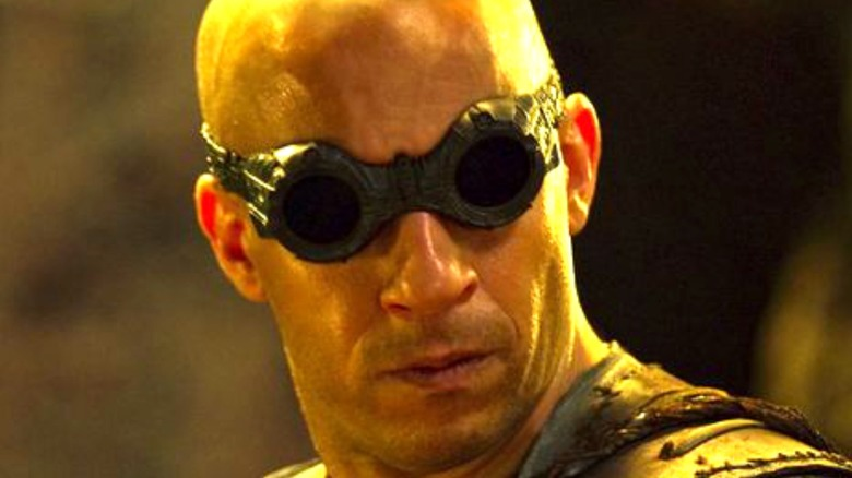 Riddick looking back in goggles