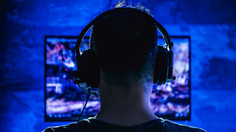guy playing games wearing headphones