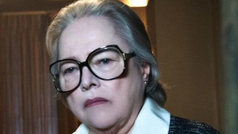 Kathy Bates looks on