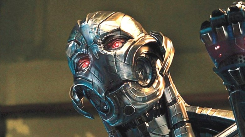 Ultron with red eyes raising fist