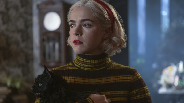 Sabrina Spellman holding Salem