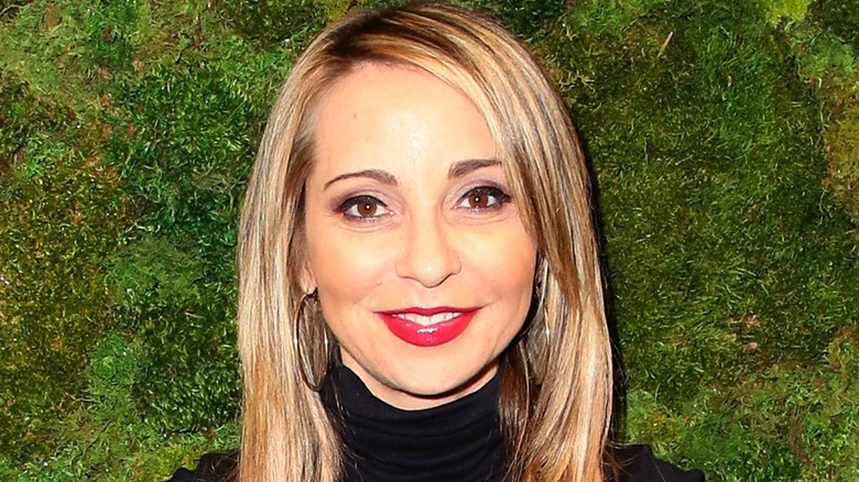 Voice actor Tara Strong smiling in close-up headshot