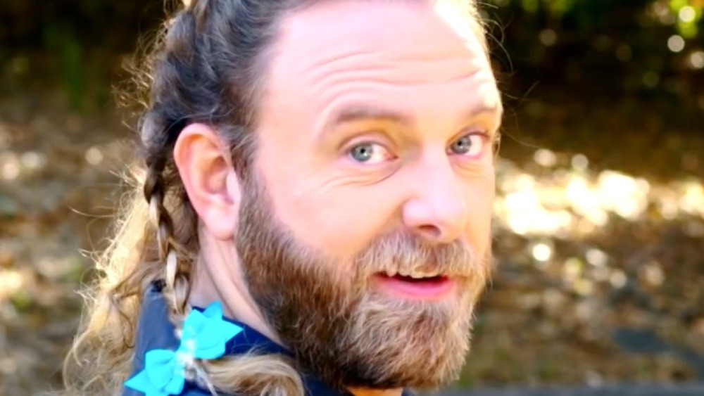 James Schrader with braided hair in the Dr. Squatch ad.