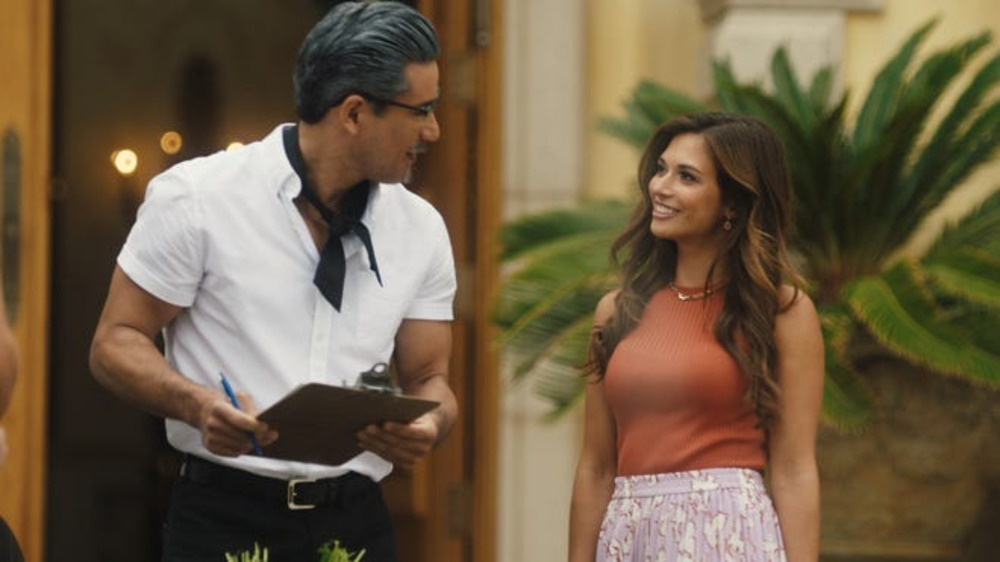 Harland Sanders (Mario Lopez) gets to know Jessica (Justene Alpert) on Lifetime's A Recipe for Seduction