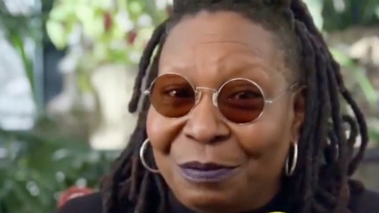 Whoopi Goldberg smiling in ad