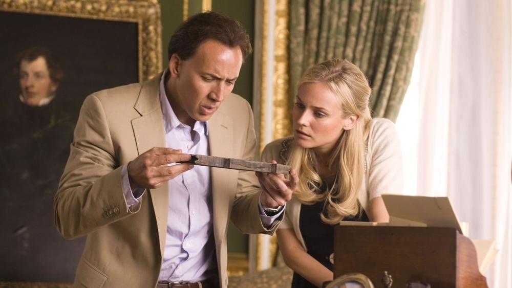 Abigail Chase and Ben Gates investigating artifact