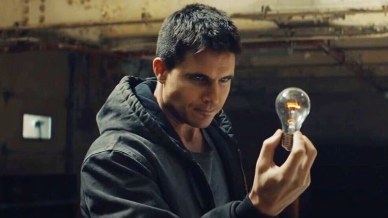 Robbie Amell as Connor Reed in Code 8