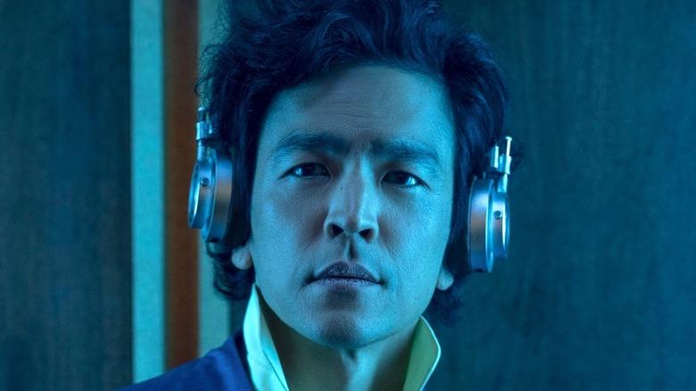 John Cho as Spike Spiegel wearing headphones