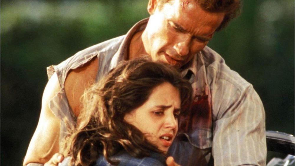 Arnold Schwarzenegger holding Eliza Dushku