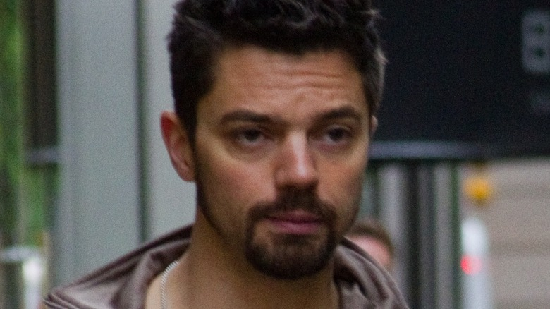 Dominic Cooper wearing a leather jacket