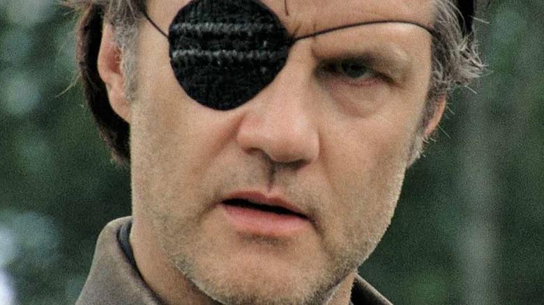 Governor with eyepatch glaring