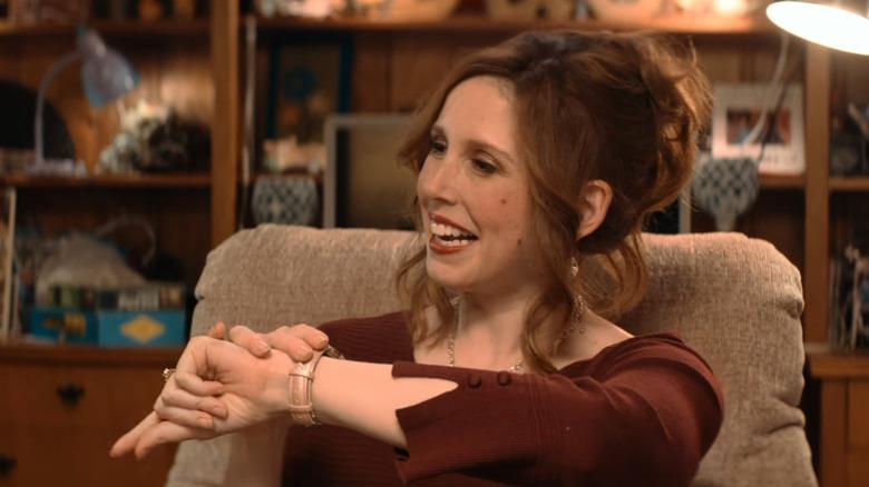 Debbie checks her watch