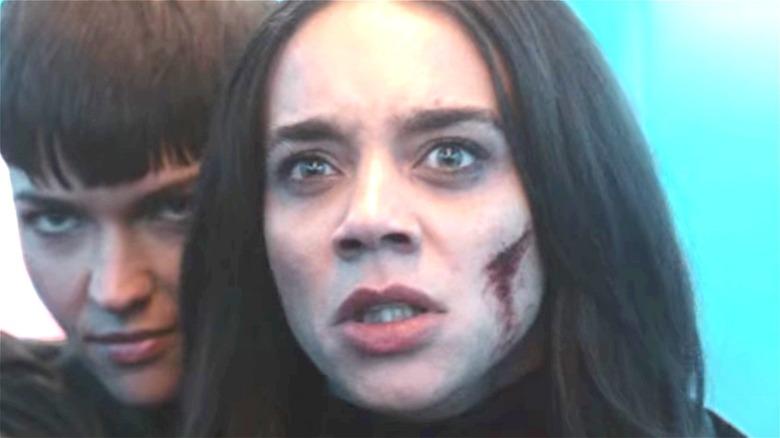 Grace Lewis holding Dr. Sophie Hart hostage