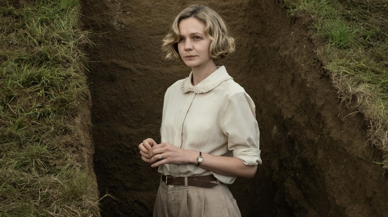 Edith standing in a grave